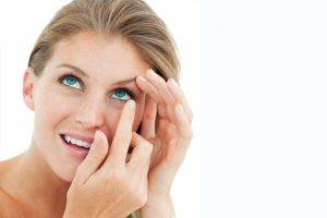 attractive blond putting in contact lens lake forest ca